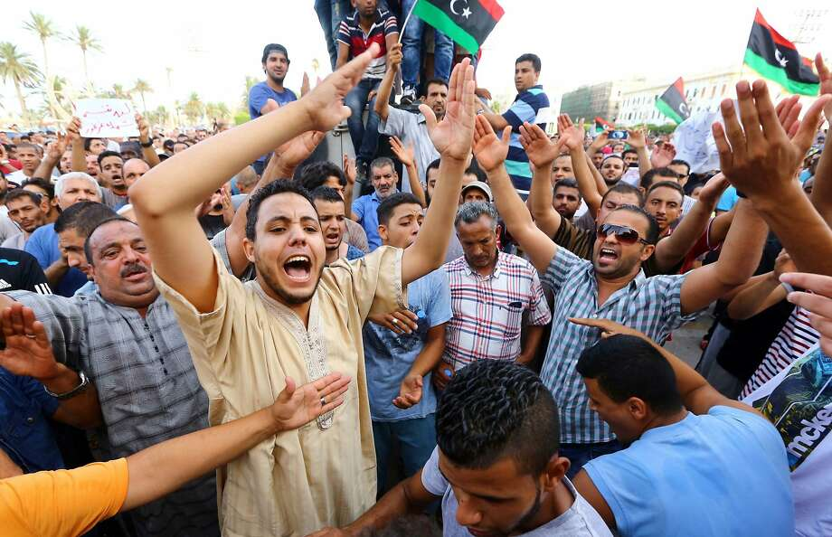 Tripoli residents protest militia violence, calling for international intervention to protect civilians. Photo: Mahmud Turkia, AFP/Getty Images