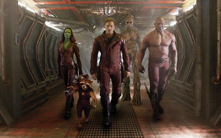 "This image released by Disney - Marvel shows, from left, Zoe Saldana, the character Rocket Racoon, voiced by Bladley Cooper, Chris Pratt, the character Groot, voiced by Vin Diesel and Dave Bautista in a scene from ""Guardians Of The Galaxy."" (AP Photo/Disney - Marvel) ORG XMIT: NYET105 / Disney - Marvel"