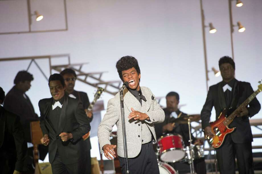 "This image released by Universal Pictures shows Chadwick Boseman in a scene from ""Get On Up."" (AP Photo/Universal Pictures) ORG XMIT: NYET151 / Universal Pictures"