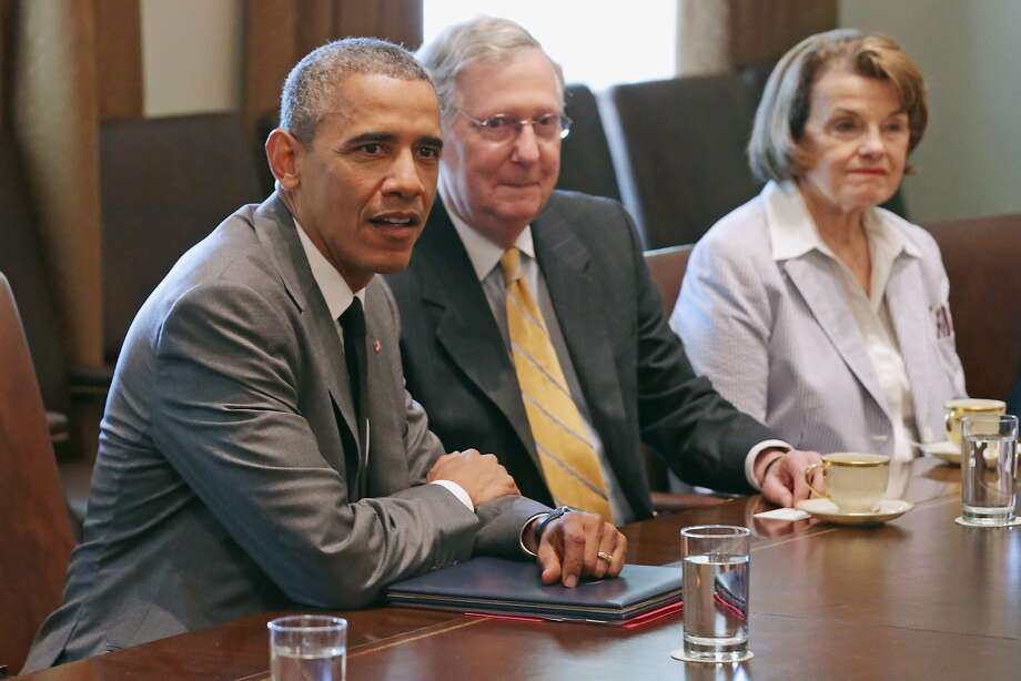 President Obama (left) meets with Senate Minority Leader Mitch McConnell, Sen. Dianne Feinstein and other lawmakers before Congress recessed for a summer break. Photo: Chip Somodevilla, Getty Images