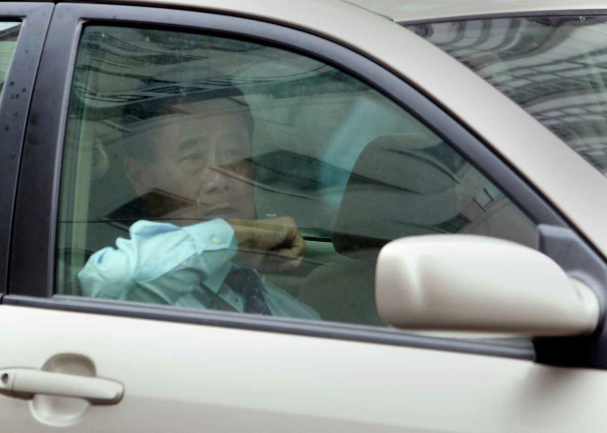 Leland Yee is driven from the Phillip Burton Federal Courthouse after hearing additional racketeering charges against him in his corruption case in San Francisco, Calif. on Thursday, July 31, 2014.
