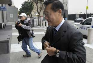 Leland Yee arrives at the Phillip Burton Federal Courthouse to hear additional racketeering charges against him in his corruption case in San Francisco, Calif. on Thursday, July 31, 2014.