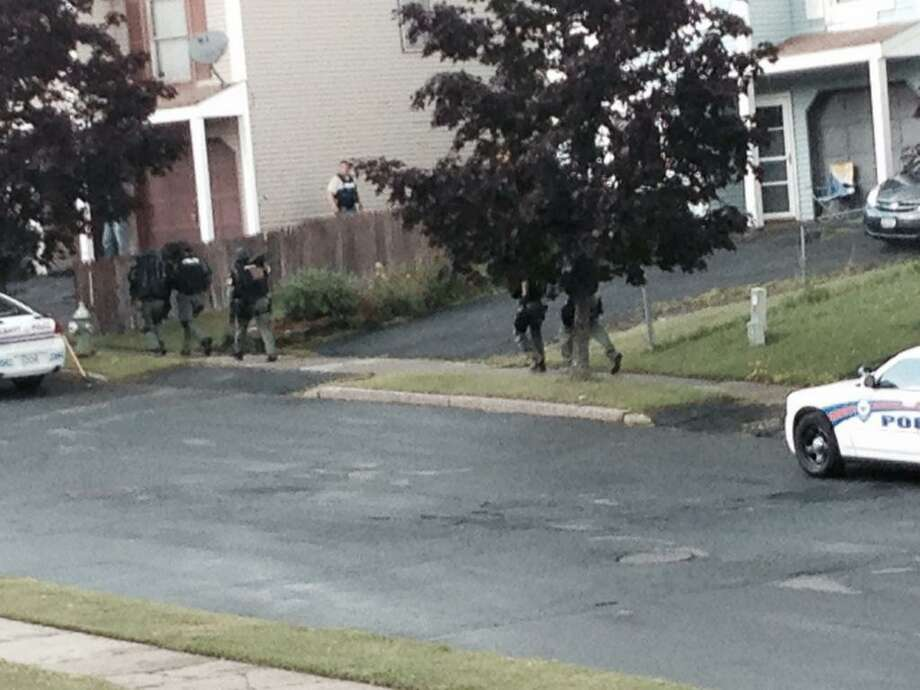 More police respond to a standoff on Albany's Lark Drive late Thursday afternoon. Lori Van Buren / Times Union)
