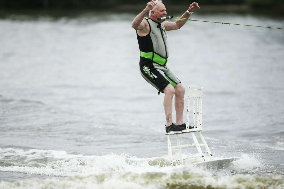 Not ready for the rocking chair:In Grand Haven,   Mich., Carl Wolters waterskis on a chair while holding a tow rope in his mouth. And he's no spring chicken. Photo: Tommy Martino, Associated Press