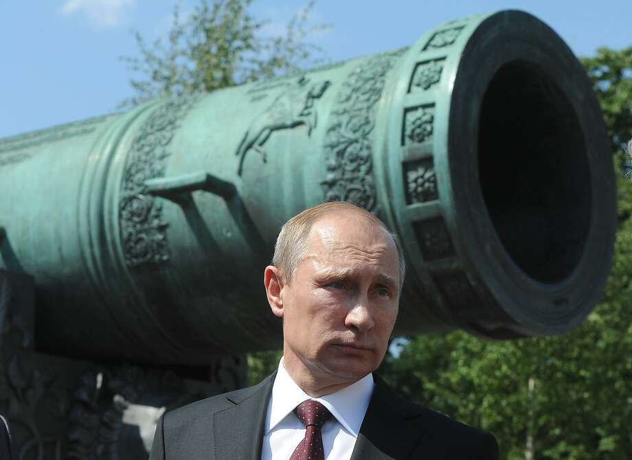The biggest cannonballs in Russia:Russian President Vladimir Putin prepares to present state awards to  cosmonauts, lawmakers, journalists and others outside the Tzar Pushka (Tzar Cannon) outside the Kremlin. Photo: Mikhail Klimentyev, Associated Press