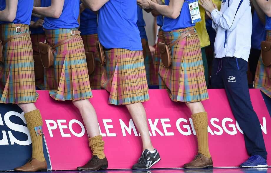 Kiltie pleasures:Members of the Scottish team cheer on fellow Scotsman Daniel Wallace as he climbs the podium to accept the silver medal in the Men's 200m Individual Medley at the 2014 Commonwealth Games in Glasgow. Photo: Andrej Isakovic, AFP/Getty Images