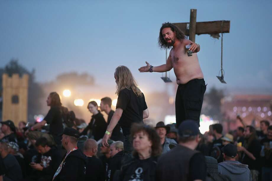 Flash those hand horns and take off those shirts ... er, not you, sir: The Wacken Open Air heavy metal festival begins in the northern German village of the same name. Some 75,000 metal-heads are expected to attend. Photo: Sean Gallup, Getty Images
