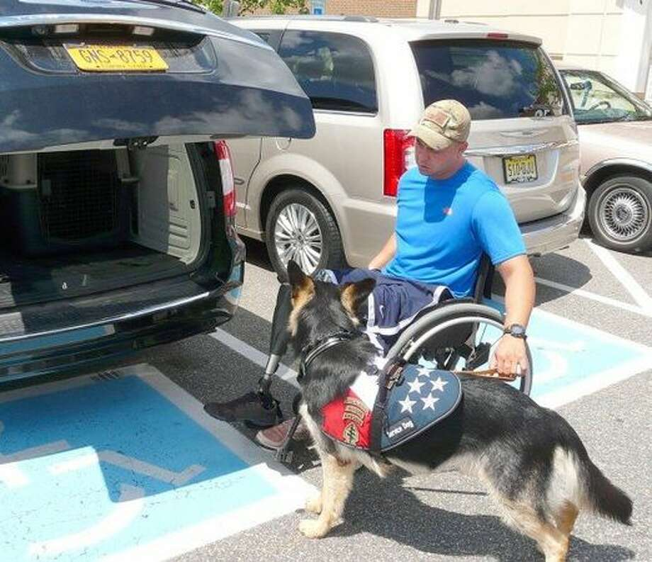 Woodlands Army Major Will Lyles lost his legs to an improvised explosive device in Afghanistan. With prosthetic limbs added the next step was the addotion of a service dog.The two met this past week, see how their training went as man and dog bonded for the first time.  Photo: Rick Epstein/Hunterdon County Democrat