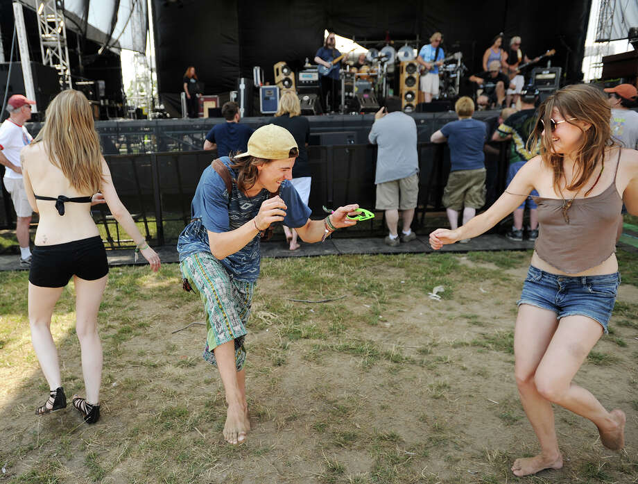 Dylan Hopkins, left, of Fairfield, and Quinn Patrick, of Burlington, VT, dance during the sound check by headliner Dark Star Orchestra at the 19th annual Gathering of the Vibes Musical Festival at Seaside Park in Bridgeport, Conn. on Thursday, July 31, 2014. Photo: Brian A. Pounds / Connecticut Post freelance
