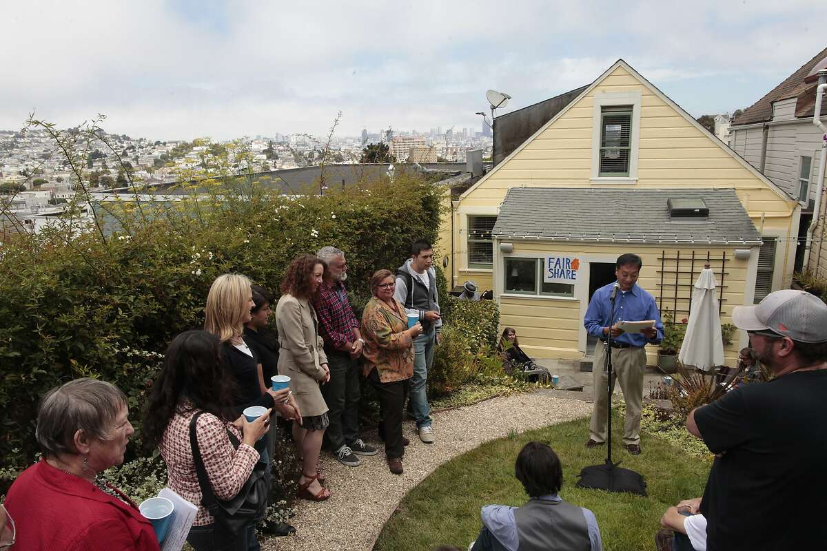 Peter Kwan addresses Airbnb hosts before allowing them to exchange stories about the home sharing service on Thursday, July 31, 2014 in San Francisco, Calif. Airbnb hosts are forming a group called Fair to Share San Francisco.
