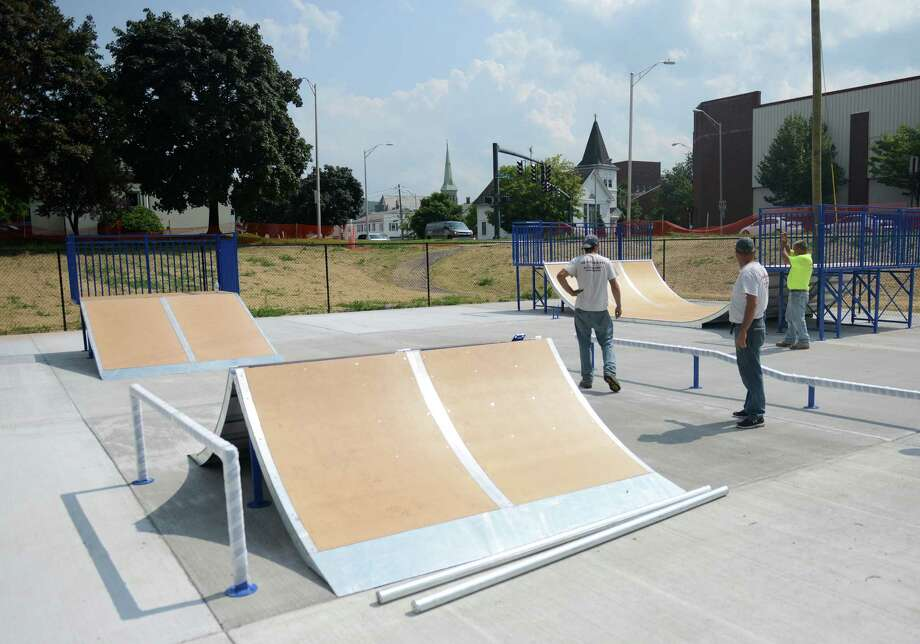 Childscapes commercial playground service, from Marshfield, Mass., sets up ramps and rails for the new skate park near the railroad station in Danbury, Conn. Thursday, July 31, 2014.  The park is expected to open before the start of the 2014 school year. Photo: Tyler Sizemore / The News-Times