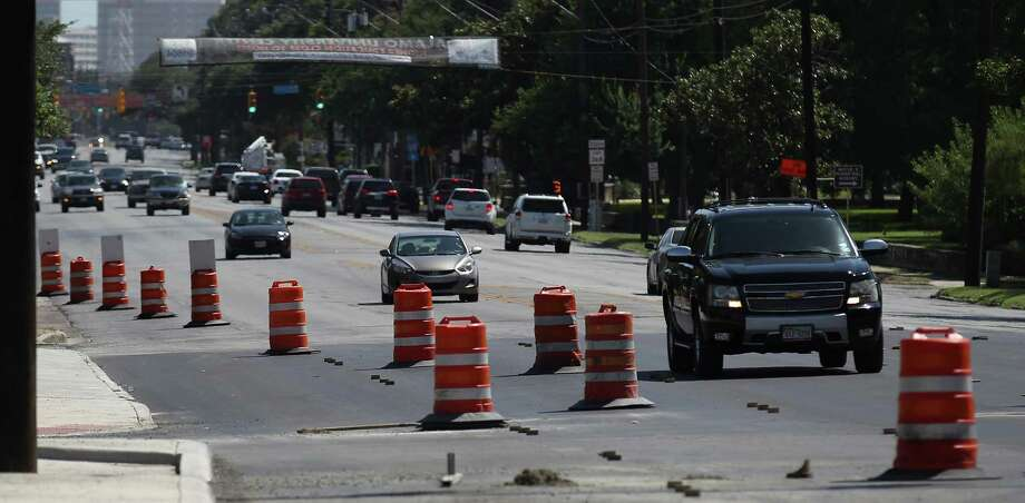 FILE PHOTO - Vehicles make their way through construction along Broadway near Hildebrand on Wednesday, July 30, 2014.  Portions of Broadway in Alamo Heights will close nightly beginning Wednesday, Feb. 1, 2017 for road repairs. Photo: Kin Man Hui, San Antonio Express-News / ©2014 San Antonio Express-News