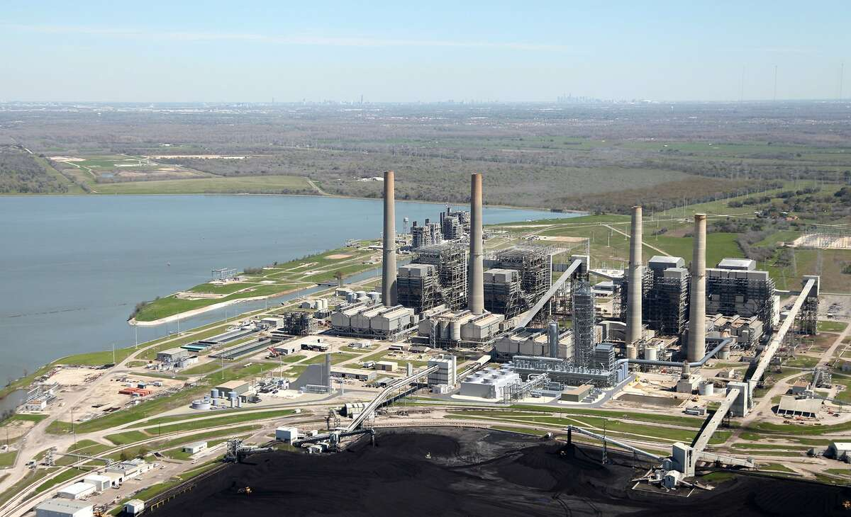 An artist's rendering depicts the new $1 billion carbon dioxide capture facility in front of the four existing towers at NRG's W.A. Parish power plant in Fort Bend County.