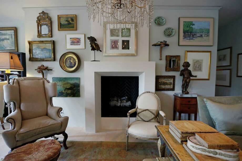Brown was inspired by a picture of a house in Belgium when she chose a sleek, modern fireplace mantel, the focal point of the living space. ( James Nielsen / Houston Chronicle ) Photo: James Nielsen, Staff / © 2014  Houston Chronicle