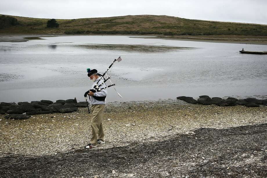 Bag piper Terry Aleshire prepares to play a few songs on the shore of the Drakes Bay Oyster Company on Thursday July 31, 2014, in Inverness, Calif. The final day that the public can purchase oysters from the Drake's Bay Oyster Company as their lease expires with the National Park Service and the area reverts to a marine sanctuary. Photo: Michael Macor, The Chronicle
