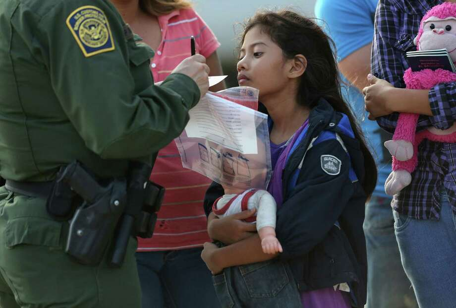 The Border Patrol processes a Salvadoran child. Resources for Central American children fall below what is legally and morally required. Photo: John Moore / Getty Images / 2014 Getty Images