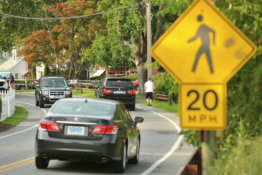 A pedestrian walks along Weed Avenue in Stamford, Conn., on Tuesday, July 29, 2014. Photo: Jason Rearick / Stamford Advocate