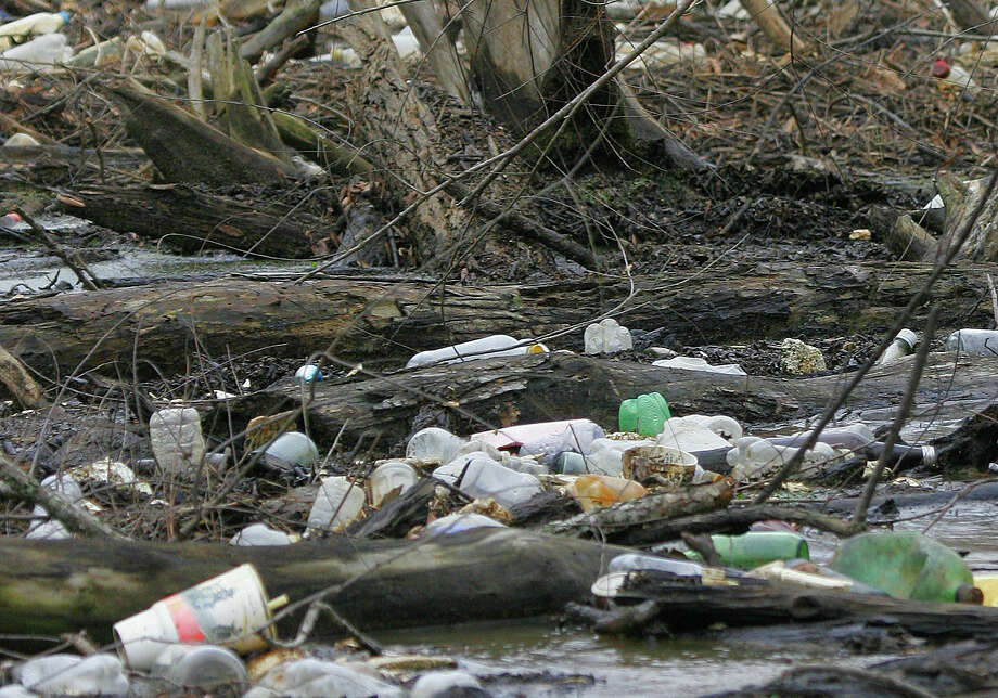 A wrack of litter, mostly plastic bottles, fouls the water and the moods of anglers on a Texas river. Photo: Shannon Tompkins / Houston Chronicle