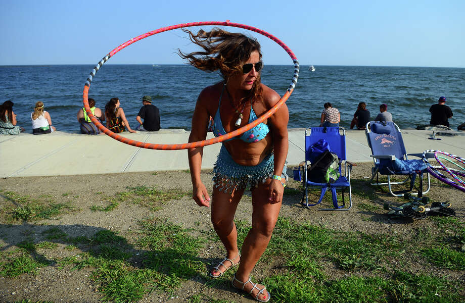 Jeannae Pendergrass, of New York, spins her hoola hoop near the Green Stage as Rusted Root performs during the 19th Annual Gathering of the Vibes Music Festival t Seaside Park in Bridgeport, Conn. on Thursday Juy 31, 2014. Photo: Christian Abraham / Connecticut Post freelance