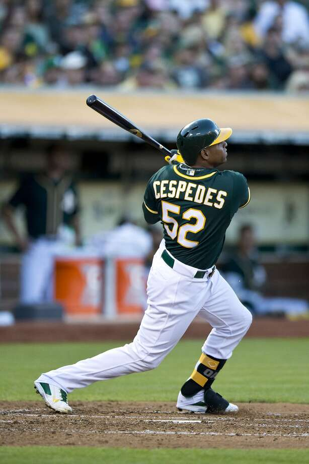 Exciting on both offense and defense, Yoenis Céspedes goes to Boston after hitting 66 homers in 2 1/2 seasons. Photo: Jason O. Watson, Getty Images