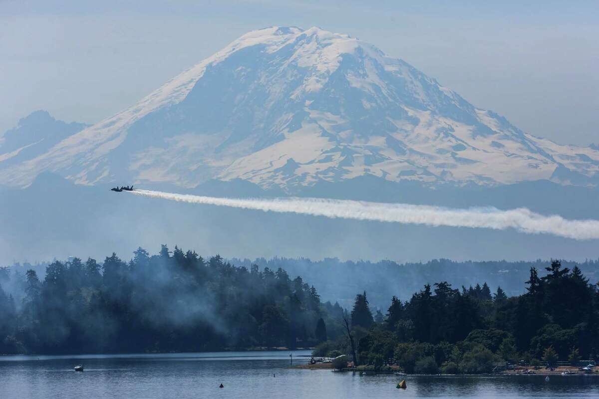 As seen from the Interstate 90 Bridge, the U.S. Navy Blue Angels perform aerial maneuvers and formations over Seattle and Lake Washington as part of a practice session on Thursday July 31, 2014. The practice caused the closing of the I-90 Bridge for parts of the morning and afternoon.
