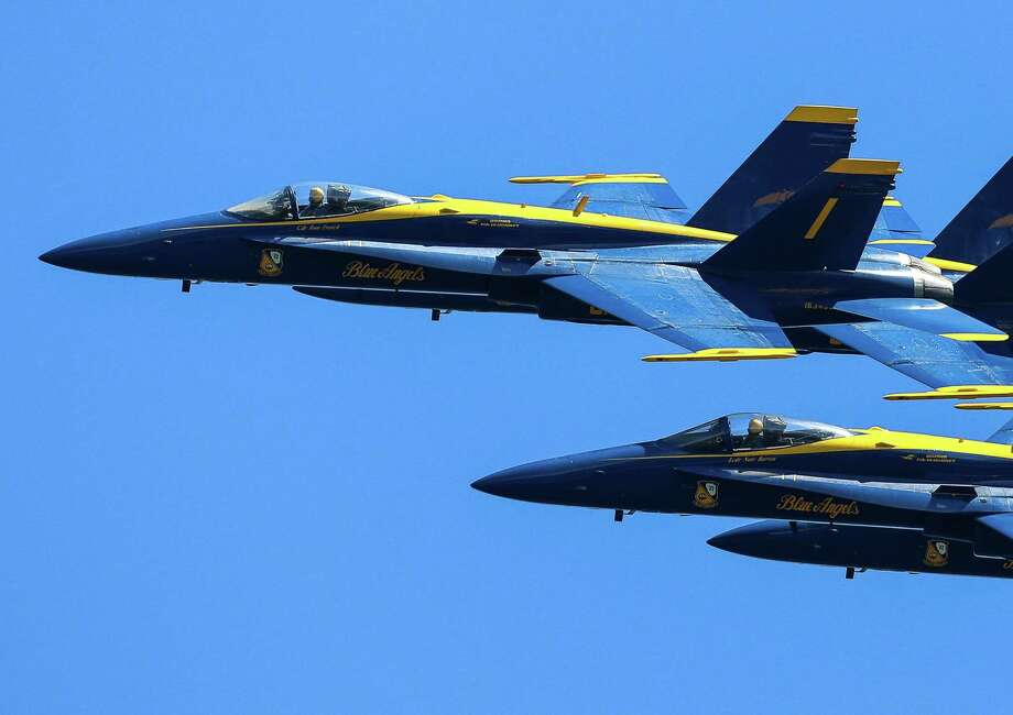 As seen from the Interstate 90 Bridge, the U.S. Navy Blue Angels perform aerial maneuvers and formations over Seattle and Lake Washington as part of a practice session on Thursday July 31, 2014. The practice caused the closing of the I-90 Bridge for parts of the morning and afternoon. Photo: JOSHUA BESSEX, SEATTLEPI.COM / SEATTLEPI.COM