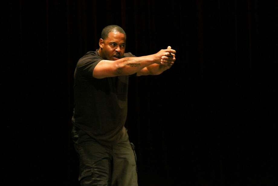 "Jinho Ferreira stars in his original solo show, ""Cops and Robbers,"" at the Marsh Berkeley. Photo: Jim Dennis"