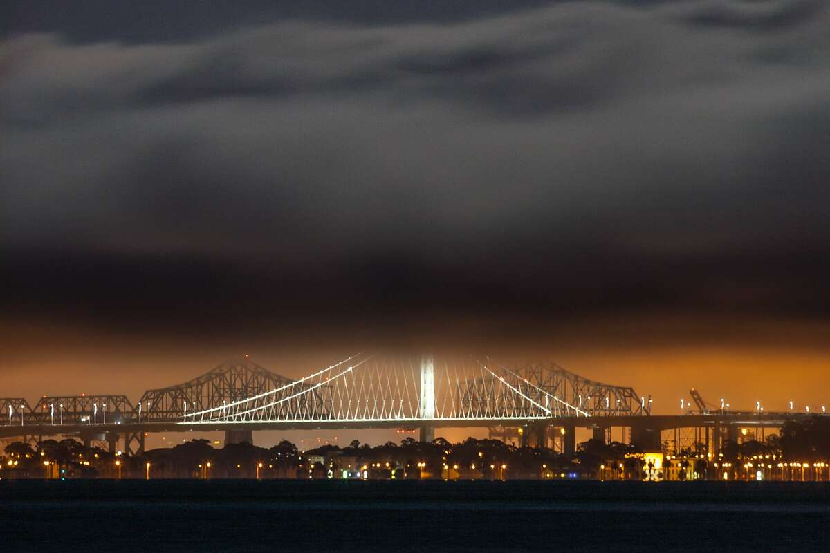 The Eastern Span of the San Francisco/Oakland Bay Bridge is shrouded in fog after the rising of the Supermoon on July 12, 2014 as seen from Sausalito, CA.