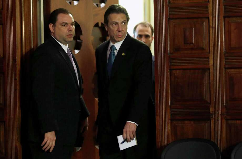 Joseph Percoco, executive deputy secretary, left, and Gov. Andrew Cuomo, right, enter the Red Room Friday, April 26, 2013, during a press conference at the Capitol in Albany, N.Y. (AP Photo/Mike Groll) Photo: Mike Groll / AP