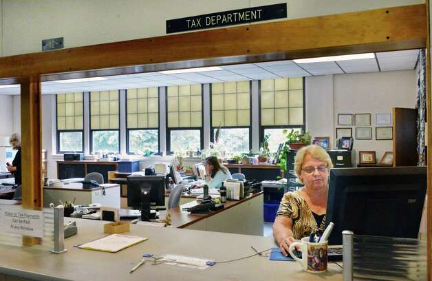 Receiver of Taxes Nancy Mendick, right, in the tax department at Bethlehem Town Hall Thursday June 5, 2014, in Bethlehem, NY.  (John Carl D'Annibale / Times Union) Photo: John Carl D'Annibale / 00027219A