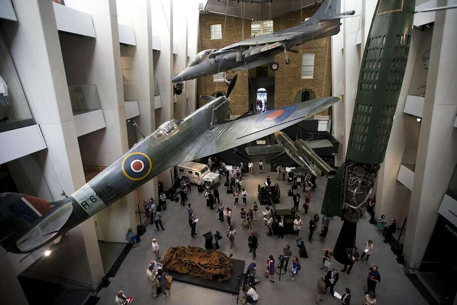 Members of the media gather during a press launch last month in the newly transformed atrium after major redevelopment works at the Imperial War Museum in London. Photo: Matt Dunham, Associated Press