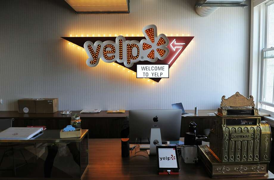 The front desk at Yelp headquarters. The company signed an eight-year lease at the 140 New Montgomery St. building, occupying about 110,000 square feet of the 250,000 square-foot building. Photo: Craig Hudson, The Chronicle