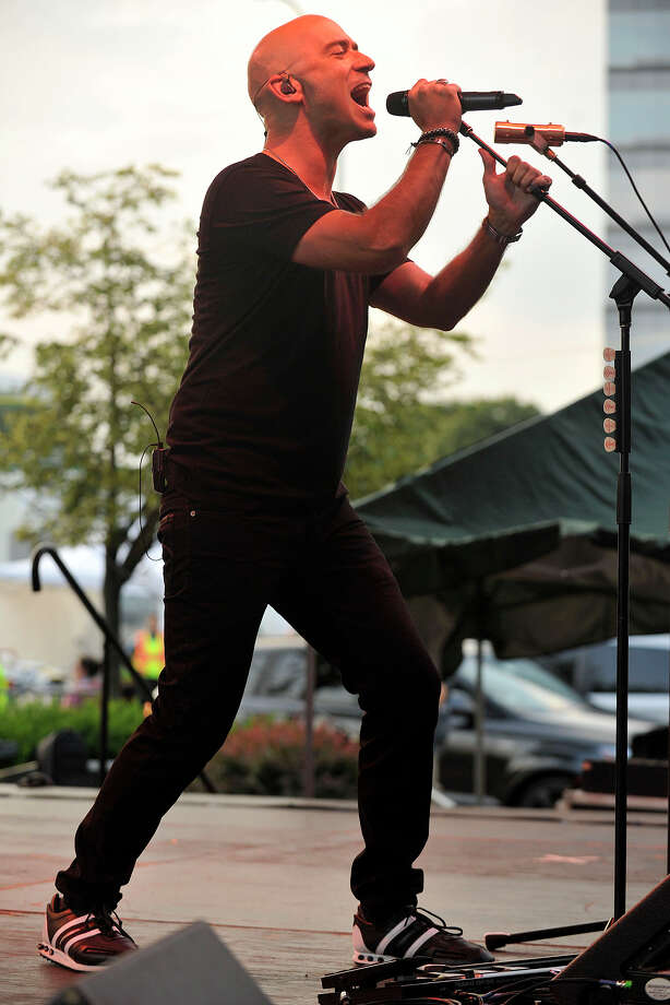 Former front man for LIVE Ed Kowalczyk performs on stage during Alive@Five in Columbus Park in Stamford, Conn., on Thursday, July 31, 2014. Hearst Connecticut Media Group is a sponsor of the event. Photo: Jason Rearick / Stamford Advocate