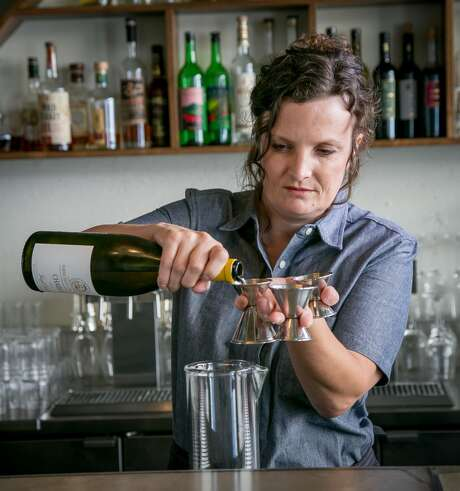 Bartender Jennifer Colliau makes a martini at the Interval Photo: John Storey, Special To The Chronicle
