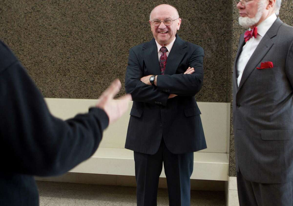 Dave Wilson chats in the hallway of the Harris County Civil Courthouse.