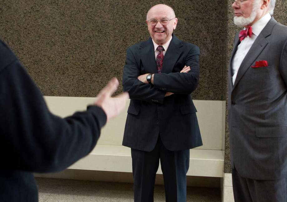 Dave Wilson chats in the hallway of the Harris County Civil Courthouse on Wednesday,. A judge declined to prohibit Wilson from taking his seat at the first meeting of the board of the Houston Community College.  Photo: Johnny Hanson, Staff / © 2014  Houston Chronicle