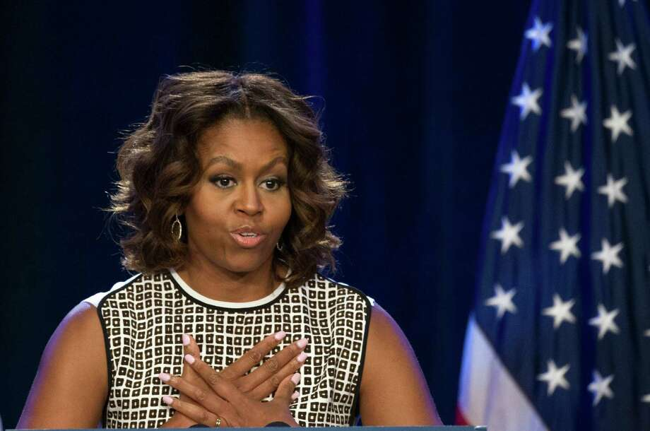 First lady Michelle Obama speaks at the 2014 National Conference on Ending Homelessness, part of the Joining Forces initiative,  Thursday, July 31, 2014,  in Washington. (AP Photo/Cliff Owen) Photo: Cliff Owen, FRE / FR170079 AP
