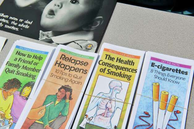 Brochures to help people trying to quit smoking are seen on display during a cookout to kick off a smoking cessation initiative focused on people with mental illness on Thursday, July 31, 2014, in Albany, N.Y.  (Paul Buckowski / Times Union) Photo: Paul Buckowski / 00028000A