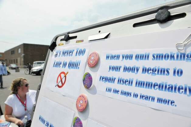 A board with information on the benefits of stopping to smoke is seen during a cookout to kick off a smoking cessation initiative focused on people with mental illness on Thursday, July 31, 2014, in Albany, N.Y.  (Paul Buckowski / Times Union) Photo: Paul Buckowski / 00028000A
