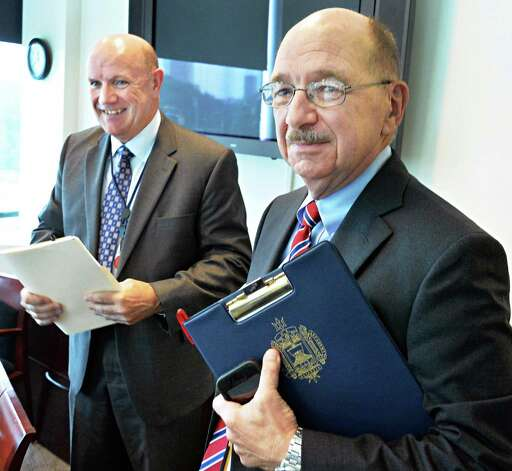 William S. Sprague, left, and Tom Louis, vice president of security and safety, at the College of Nanoscale Science and Engineering Thursday, July 31, 2014, in Albany, N.Y. The SUNY College of Nanoscale Science and Engineering is getting its own police force, a move that comes as the college has separated from the nearby University at Albany. (John Carl D'Annibale / Times Union) Photo: John Carl D'Annibale / 00028009A
