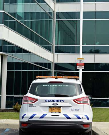 A security vehicle at the College of Nanoscale Science and Engineering of the State University of New York Thursday July 31, 2014, in Albany, NY. The SUNY College of Nanoscale Science and Engineering is getting its own police force, a move that comes as the college has separated from the nearby University at Albany. (John Carl D'Annibale / Times Union) Photo: John Carl D'Annibale / 00028009A