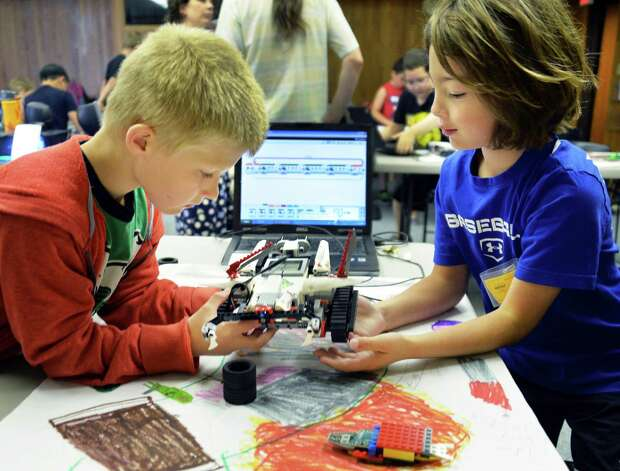 Braiden Pulver, 7, and George Habeeb, 8, both of Clifton Park,  program a Lego robot to navigate an obstacle course during a miSci summer class Thursday, July 31, 2014, in Schenectady, N.Y.  (John Carl D'Annibale / Times Union) Photo: John Carl D'Annibale / 00028004A