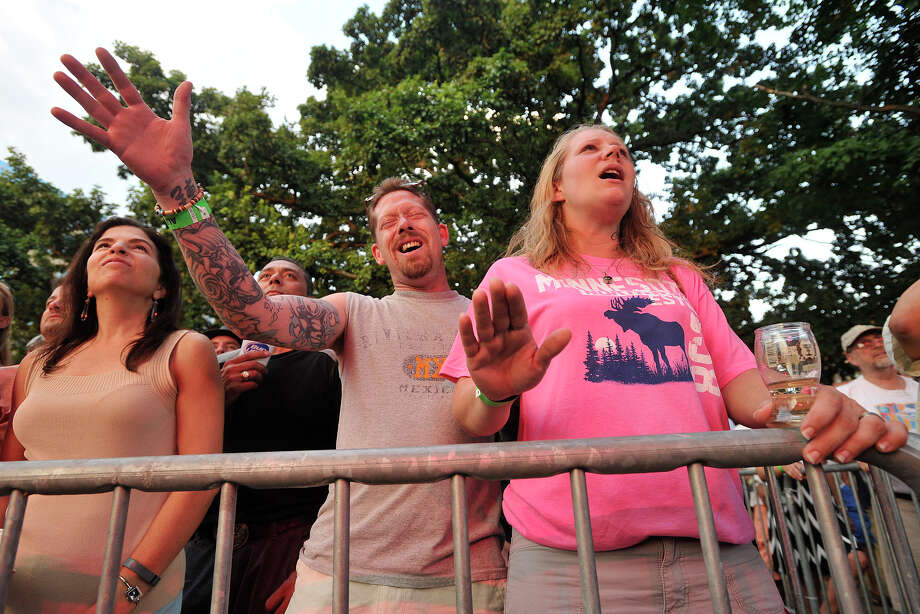 Kevin Graham and Melissa Graham, of Windsor, rock out to Ed Kowalczyk during Alive@Five in Columbus Park in Stamford, Conn., on Thursday, July 31, 2014. Hearst Connecticut Media Group is a sponsor of the event. Photo: Jason Rearick / Stamford Advocate