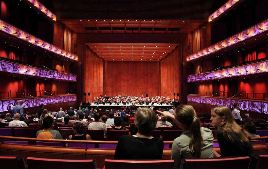 Music patrons slowly fill the new Tobin Center for the Performing Arts for an acoustical test-run performance called, The Science of Sound, on Thursday, July 32, 2014. Over 800 guests participated in a sound test session with the help of Youth Orchestra of San Antonio for acoustical experts, Akustiks, who are in the process of fine-tuning the venue for optimal sound. The first actual performance will be in September. Photo: Kin Man Hui, San Antonio Express-News / ©2014 San Antonio Express-News