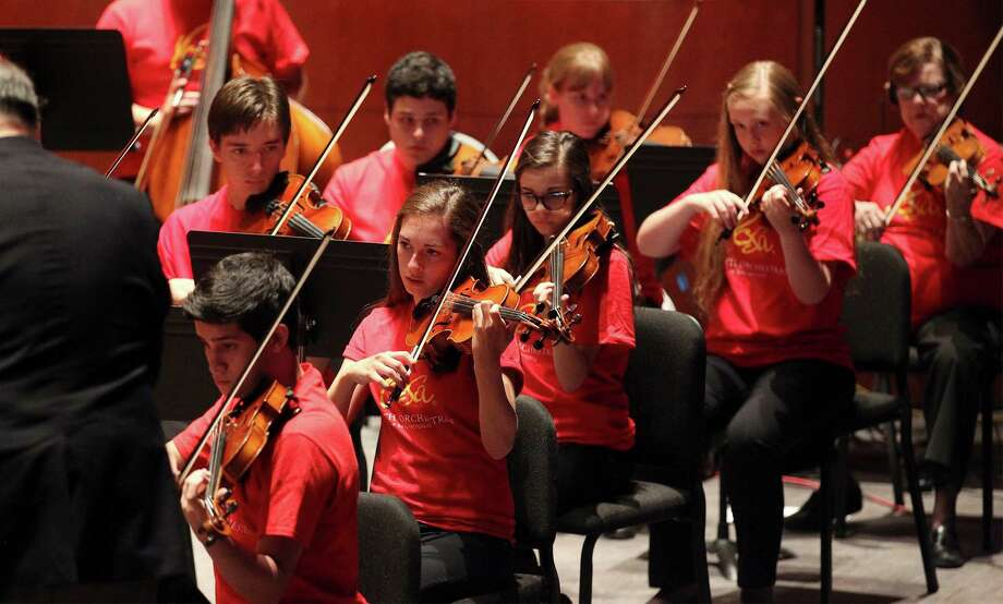 Performers with Youth Orchestra of San Antonio play for  music patrons at the new Tobin Center for the Performing Arts for an acoustical test-run performance called, The Science of Sound, on Thursday, July 32, 2014. Over 800 guests participated in a sound test session with the help of Youth Orchestra of San Antonio for acoustical experts, Akustiks, who are in the process of fine-tuning the venue for optimal sound. The first actual performance will be in September. Photo: Kin Man Hui, San Antonio Express-News / ©2014 San Antonio Express-News