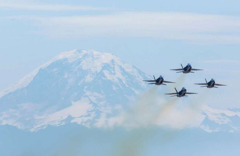 The U.S. Navy Blue Angels take off from Boeing Field for aerial maneuvers and formations over Seattle and Lake Washington as part of a practice session on Thursday July 31, 2014. The Blue Angels will perform at the annual Seafair summer celebration. Photo: JOSHUA TRUJILLO, SEATTLEPI.COM / SEATTLEPI.COM