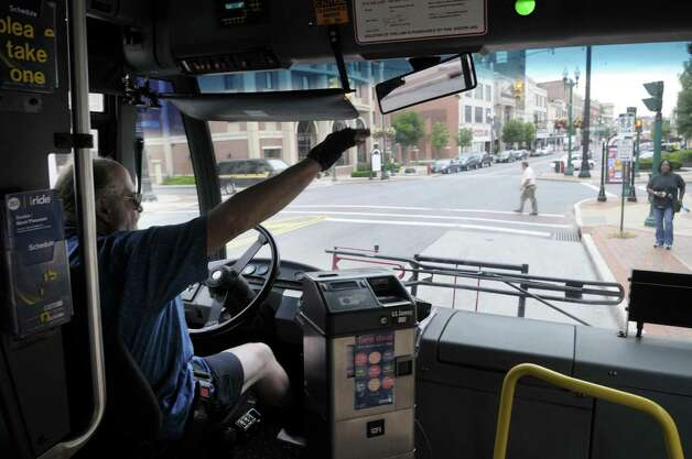 CDTA bus driver Warren Sheldon waves to a passenger as he pulls into a stop Tuesday afternoon, June 28, 2011, in Rotterdam, N.Y.  (Paul Buckowski / Times Union archive) Photo: Paul Buckowski / 00013702A