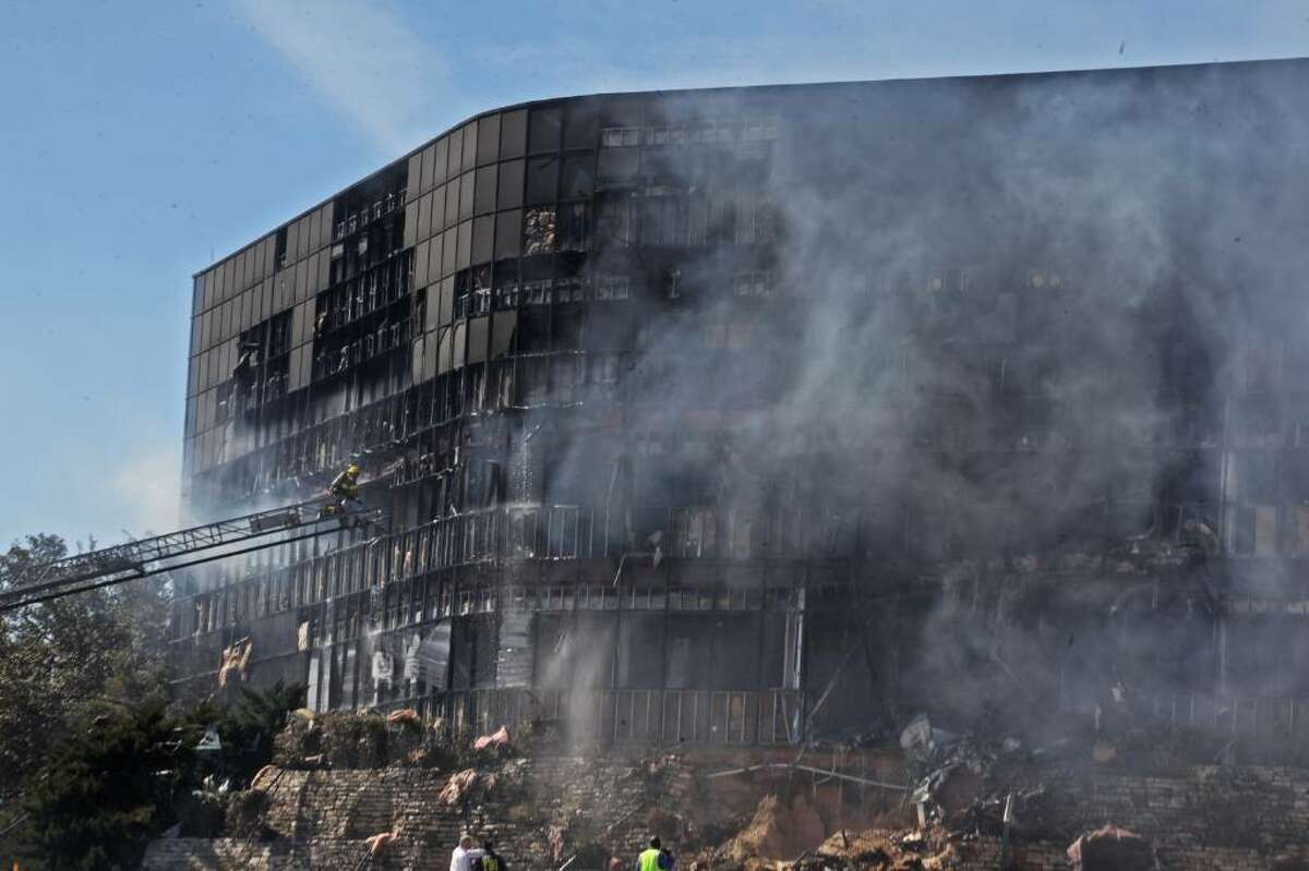 AUSTIN, TX - FEBRUARY 18: Smoke billows from a building that houses IRS offices after a small plane crashed into it February 18, 2010 in Austin, Texas. According to reports, the pilot, identified as Joseph A. Stack III, was killed in the crash. (Photo by Jana Birchum/Getty Images)