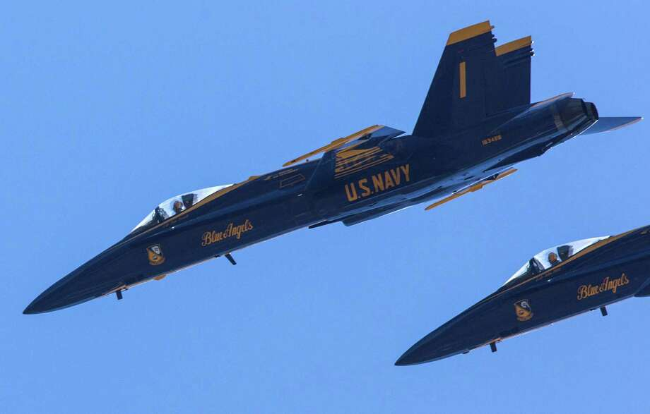 The U.S. Navy Blue Angels perform aerial maneuvers and formations over Seattle and Lake Washington as part of a practice session on Thursday July 31, 2014. The Blue Angels will perform at the annual Seafair summer celebration. Photo: JOSHUA TRUJILLO, SEATTLEPI.COM / SEATTLEPI.COM