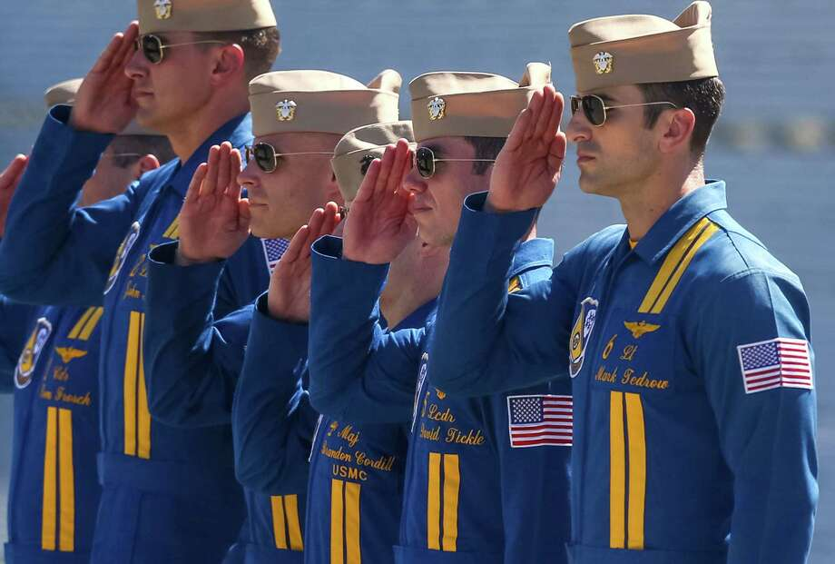 U.S. Navy Blue Angels pilots salute after a practice session on Thursday July 31, 2014. The Blue Angels will perform at the annual Seafair summer celebration. Photo: JOSHUA TRUJILLO, SEATTLEPI.COM / SEATTLEPI.COM